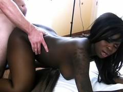 Splendid tattooed ebony chick with humongous tits Tatiyana Foxx gets a wild nasty fuck inside a hotel room