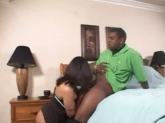 On her knees to engulf chubby black cock
